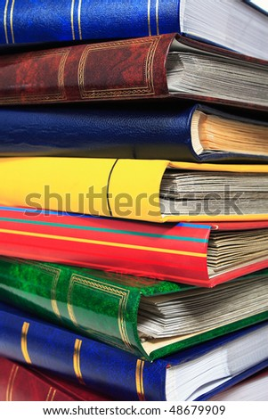 pile of books in closeup  on white background - stock photo