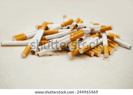 Pile of cigarettes scattered. Close up, selective focus.  - stock photo