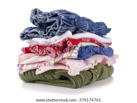 pile of colorful children's clothing on a white background. - stock photo