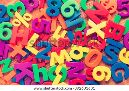 Pile of colorful toy magnets. Cross processed to create retro effect. - stock photo