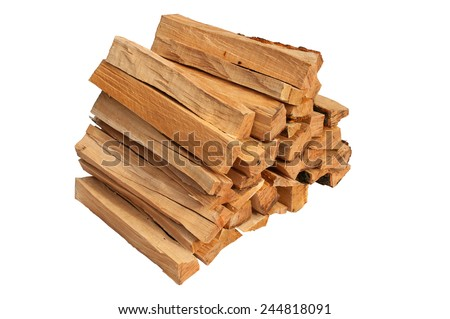 Pile of firewood isolated on a white background - stock photo