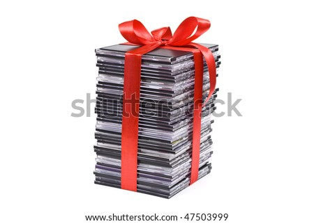 Pile of optical disc with red ribbon - stock photo