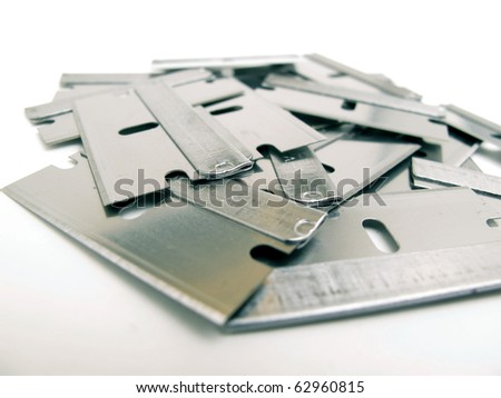 pile of razor blades isolated on white background - stock photo