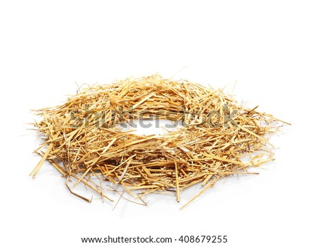 pile of straw forming round frame, nest background and texture - stock photo