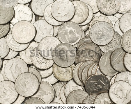Pile of US Half Dollars Fifty Cent Pieces $.50 - stock photo