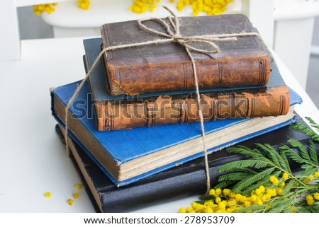 pile of vintage old books  on white table - stock photo