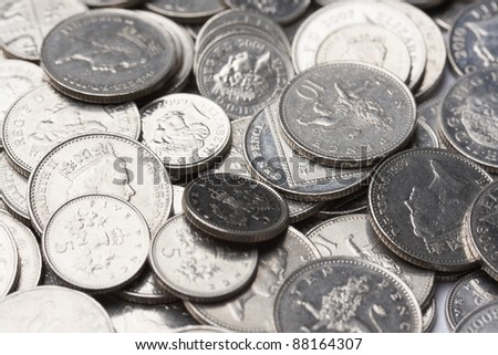 piles of silver coins; financial growth - stock photo