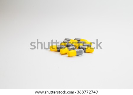 Pill capsules on white background - stock photo