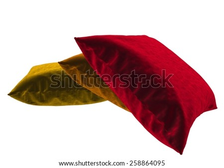 3 pillow - red, orange and yellow isolated on white background - stock photo