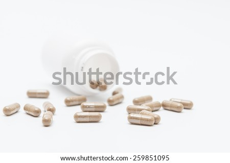 pills an pill bottle on white background