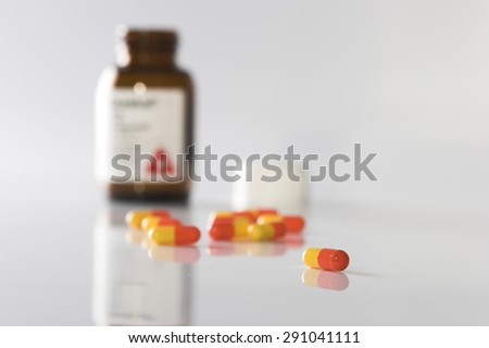 Pills and pill bottle - stock photo