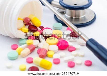 Pills ,tablets and stethoscope on white background - stock photo