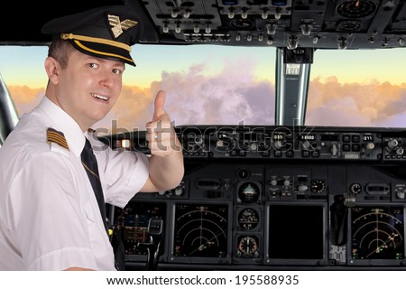 Pilot in cockpit shows thumbs up