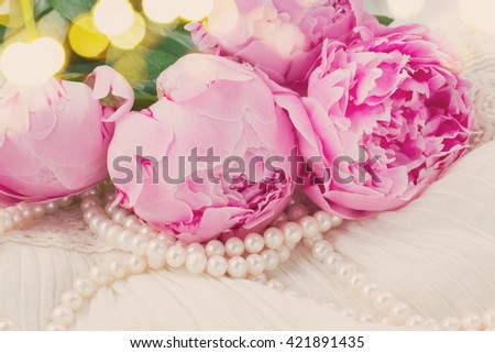 pink  peony flowers with pearls on white, retro toned