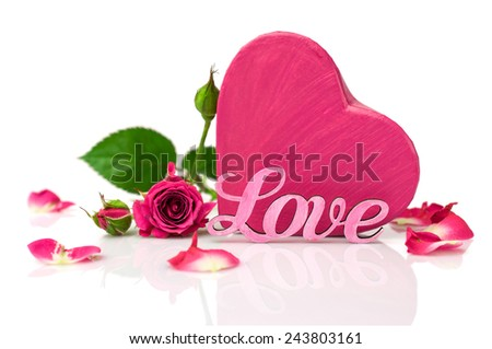 """Pink word """"love"""", gift box in the shape of hearts and roses isolated on white  - stock photo"""