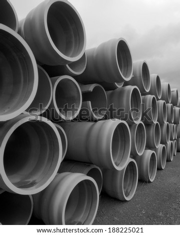 "30"" Pipe stacked for use in future pipeline.  This is non-metallic PVC blue pipe used for water - stock photo"