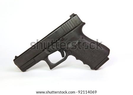 pistol on white background - stock photo