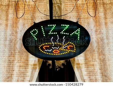 Pizza Sign In Cafe Window - stock photo