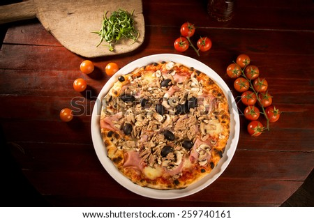 Pizza with chicken and olives - stock photo