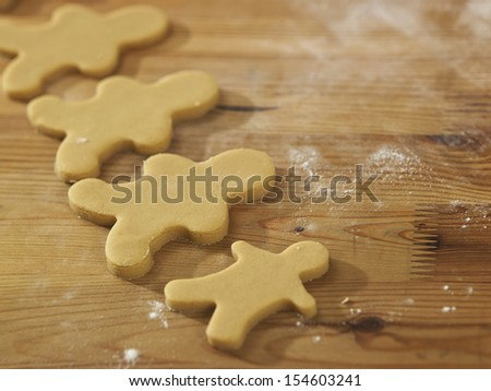 Plain gingerbread man on table