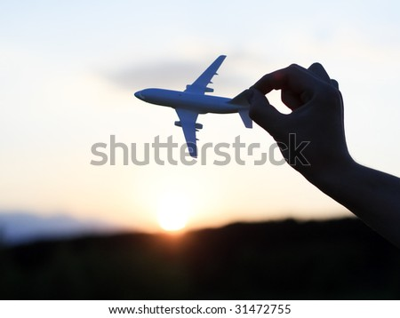 plane at sunset - stock photo