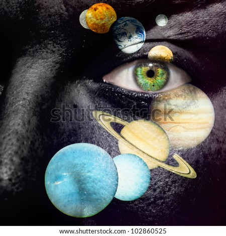 9 planet system painted on a face - stock photo