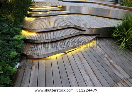 Plank Wood Stair Outdoor In Flower Garden ,pathway On Ground Floor In Yard