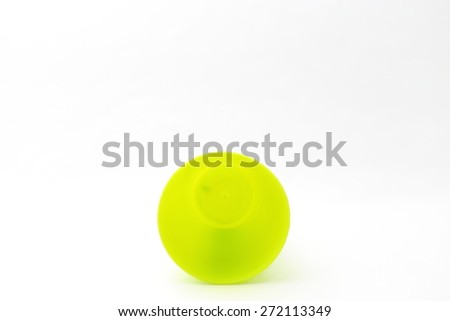 plastic green cup on white background - stock photo