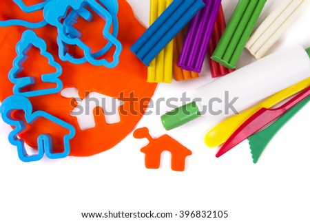 Plasticine and tools on white background - stock photo