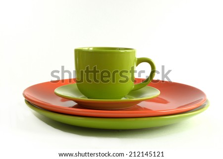 plates and tea cup isolated on white background