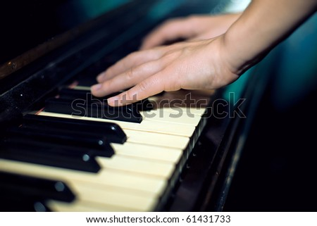 play  on  old upright piano - stock photo