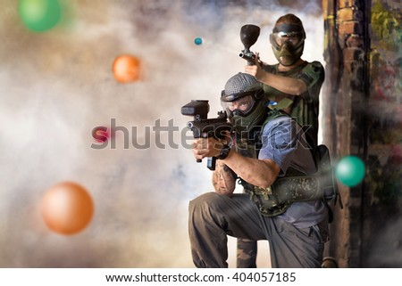 Play paintball game, two player with guns  - stock photo