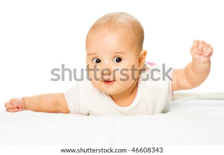 playing baby is on abdomen and white background