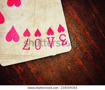 playing cards with the word love toned with a vintage grunge instagram like effect - stock photo