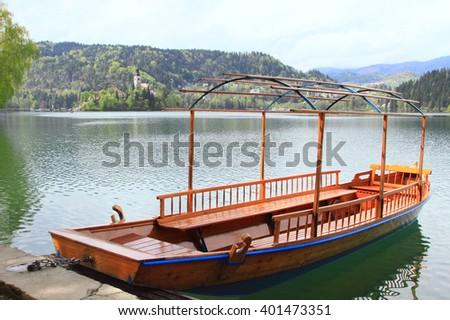 pletna boat at alpine Lake Bled in Slovenia - stock photo