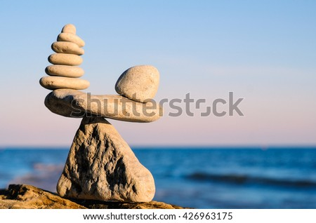 Poise of stones on the seashore - stock photo