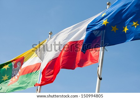 Polish flag against the sky - stock photo