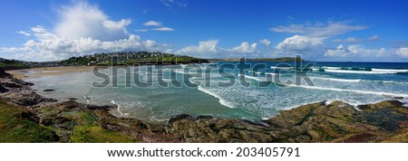 Polzeath, North Cornwall, United Kingdom, surfers and bathers in the Sea