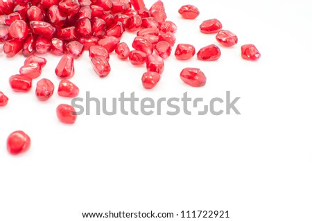 pomegranate seeds isolated on white selective focus