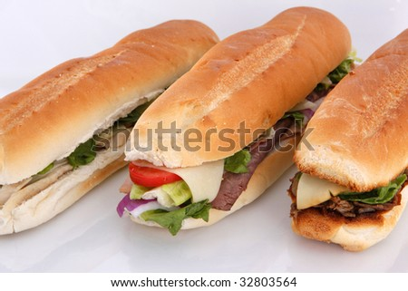 3 popular sandwiches - Chicken Caesar, Deli giant and Philly on white - stock photo