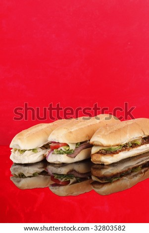 3 popular sandwiches - Chicken Caesar, Deli giant and Philly - Poster - stock photo