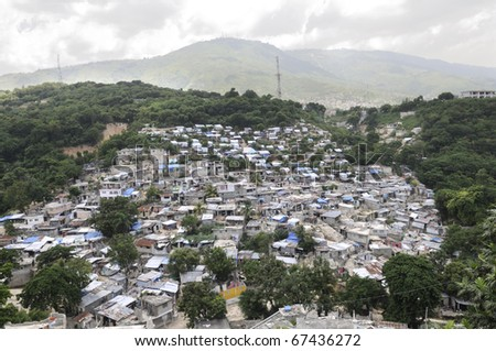 PORT-AU-PRINCE - AUGUST 26:  An Haitian village in the valley region which was severely hit during the earthquake in January,  in Port-Au-Prince, Haiti on August 26, 2010. - stock photo