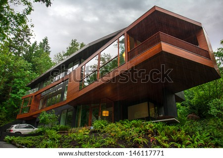 "PORTLAND, OR - MAY 25: The house used as a residence for the vampire family ""Cullens"" in ""Twilight"" on May 25, 2013 in rainy weather, much like in the movie. - stock photo"