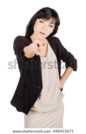 Portrait angry business woman pointing fingers at you camera gesture isolated on white wall background. Negative human emotions face expression - stock photo