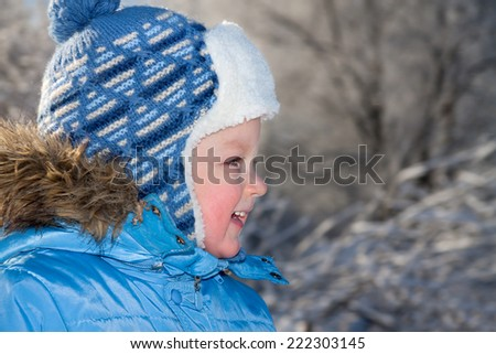 portrait happy small child the boy on walk in the winter in park - stock photo