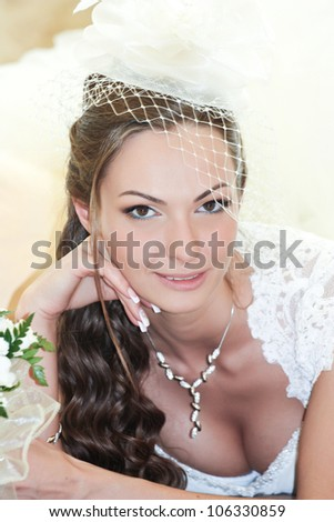 Portrait laughing bride with bouquet