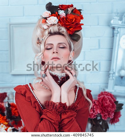 portrait of a beautiful lady in a baroque style , vintage atmosphere with candles and flowers in the head , hip toning , creative color - stock photo