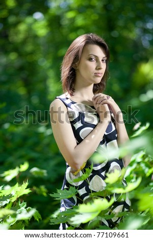 Portrait of a beautiful young woman in summer park, European, White, Caucasian - stock photo