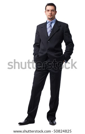 Portrait of a confident young  businessman with hands in pockets on white background. - stock photo