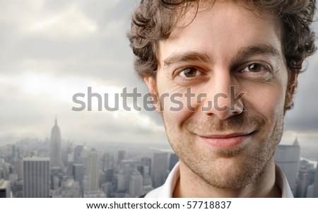 portrait of a glad man with landscape - stock photo